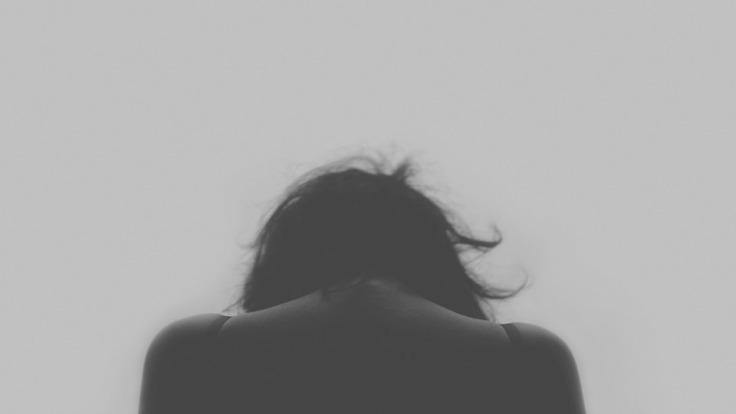 dolor de mujer